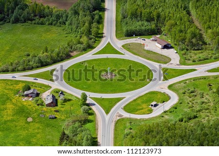 aerial view over road intersection - stock photo