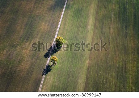 Aerial view over rural fields in autumn - stock photo