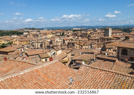 Aerial view over Siena (city in Tuscany) in Italy, Europe - stock photo