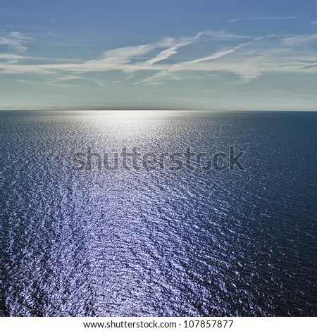 aerial view over the blue sea - stock photo