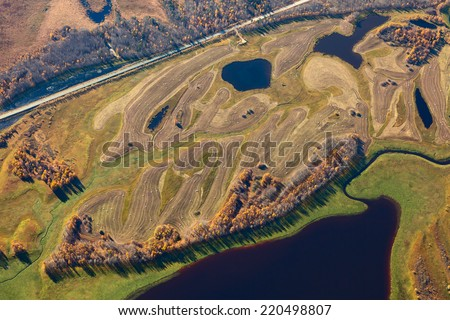 Aerial view over the meadows of cut grass - stock photo