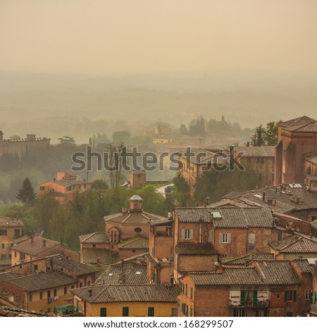 Aerial view over the medieval city of Siena - stock photo