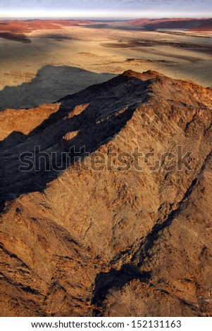 Aerial view over the Namib-nuakluft Desert near Sossusvlie in Namibia - stock photo