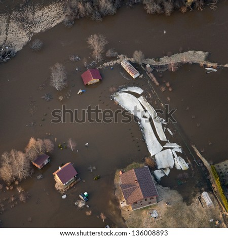Aerial view over the over flooded river in springtime - stock photo