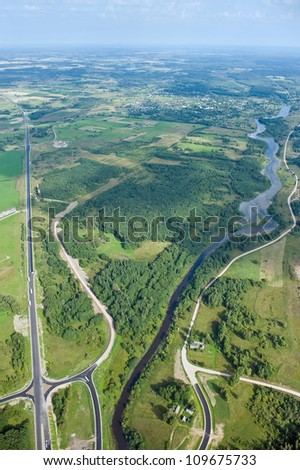 aerial view over the road and the river - stock photo