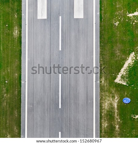 Aerial view over the runway approach at the airport - stock photo