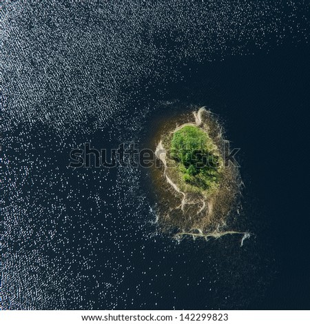 Aerial view over the small island - stock photo