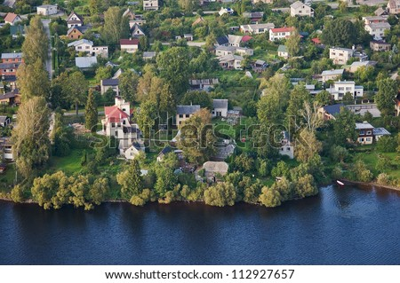 aerial view over the small village - stock photo