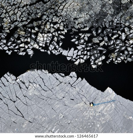 aerial view over the surface of river and cracked ice - stock photo