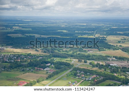 aerial view over the village - stock photo