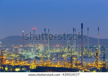 Aerial view petrochemical factory at twilight with mountain background - stock photo