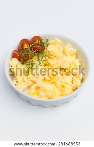Aerial view tasty fresh scrambled eggs on plate white background  Breakfast omelet eggs with red cherry tomatoes perfect for food, cooking gastronomy concept magazines - stock photo