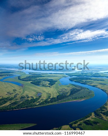 Aerial view the great river during summer day on background of white clouds which reflect in water. - stock photo