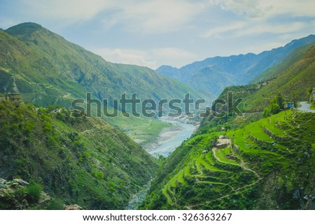 Aerial view to desert mountains with river and lake - stock photo