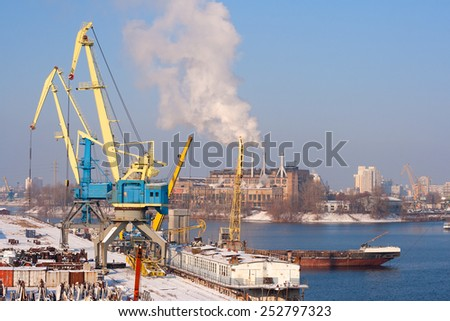 Aerial view to empty cargo dock with cranes and containers - stock photo
