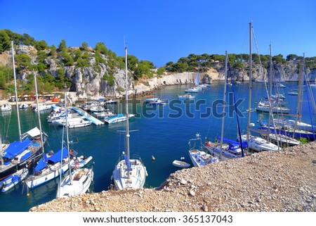 Aerial view to luxury yachts inside a calanque near Cassis, France - stock photo