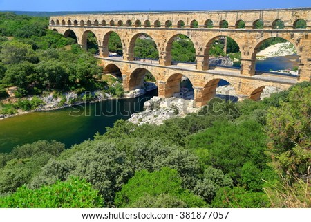 Aerial view to medieval aqueduct of Pont du Gard near Nimes, France - stock photo