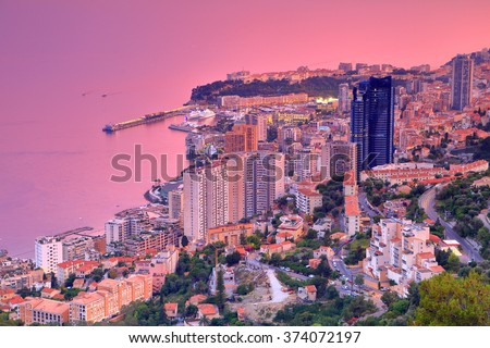 Aerial view to Mediterranean sea and Monte Carlo at dusk, Monaco, French Riviera - stock photo