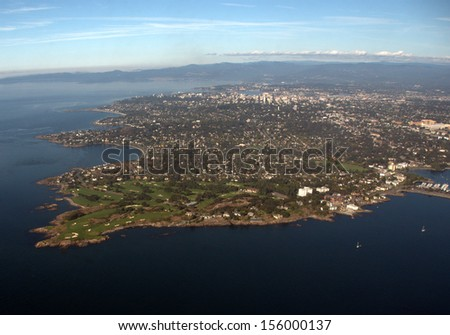 Aerial view Victoria, British Columbia, Canada from east.  The wealthy Oak Bay community is in the foreground, the city in the center top and the University of Victoria on the right. - stock photo