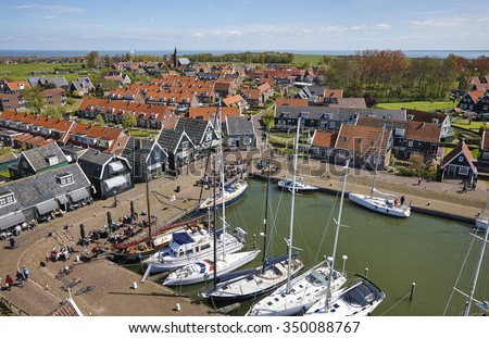 Aerial view with the harbor of he town of Marken, that used to be an island in the former Zuiderzee (Southern Sea), the Netherlands - stock photo
