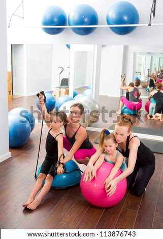 Aerobics pilates women kid girls personal trainer instructors at gym - stock photo