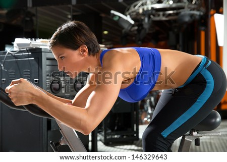 Aerobics trainer at gym at training class - stock photo