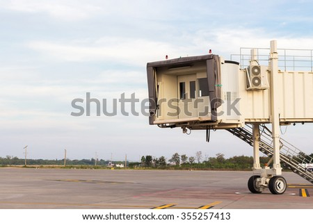 Aerobridge waiting for a plane to arrive on airport - stock photo