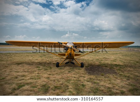 aeroplane waiting for a start, on grass - stock photo