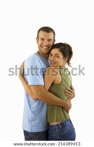 Affectionate couple embracing, smiling, side view, portrait, cut out - stock photo