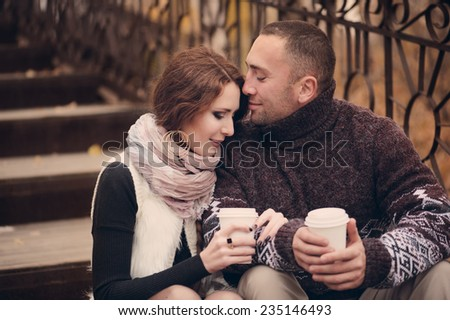 Affectionate couple in love dating in autumn city - stock photo