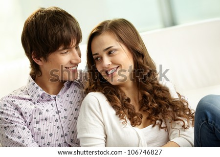 Affectionate couple spending time together at home - stock photo