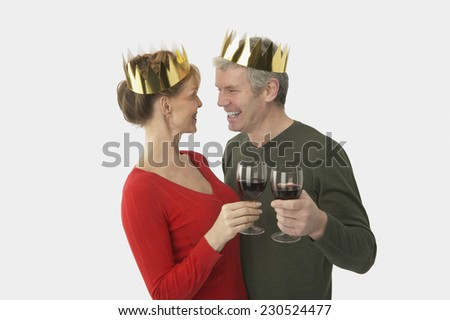 Affectionate Couple Toasting with Red Wine - stock photo