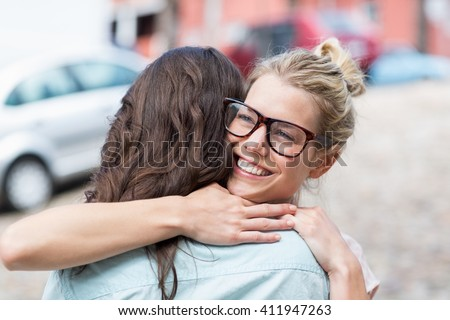 Affectionate friends embracing each other - stock photo