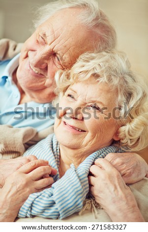 Affectionate grandparents enjoying being together - stock photo