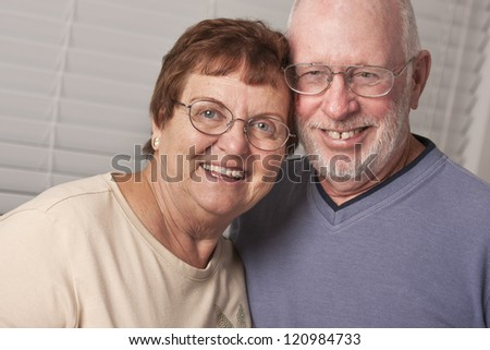 Affectionate Happy Senior Couple Portrait Indoors. - stock photo