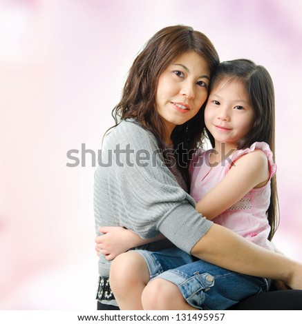 Affectionate Mother And Daughter At Home. Asian parent and child. - stock photo