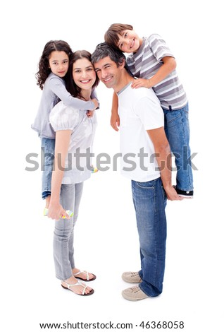 Affectionate parents giving their children a piggyback ride against a white background - stock photo
