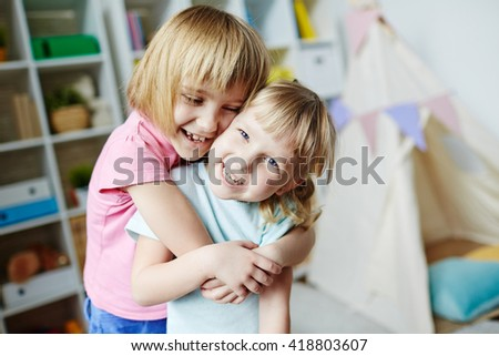 Affectionate sisters - stock photo