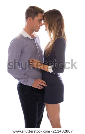 Affectionate young couple touching foreheads as they share a tender moment standing close together face to face, on white - stock photo