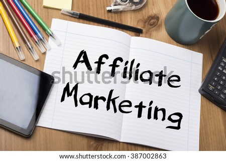 Affiliate Marketing - Note Pad With Text On Wooden Table - with office  tools - stock photo
