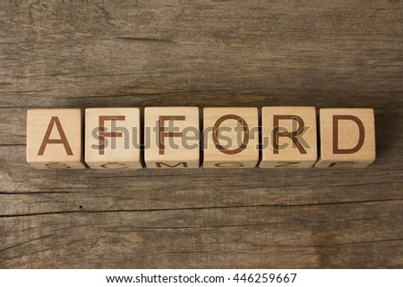 AFFORD word on wooden cubes - stock photo