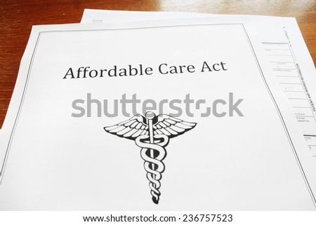 Affordable Care Act / Obamacare document on a desk                                - stock photo