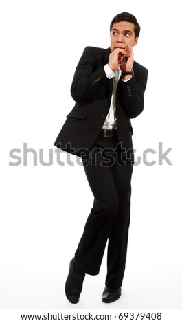 Afraid businessman showing frightening gesture and looking aside - stock photo