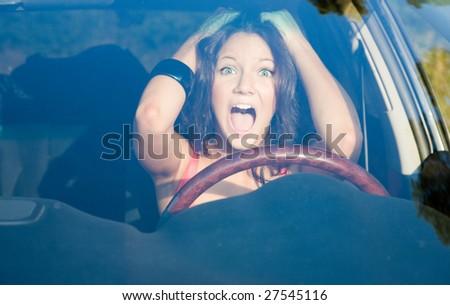 afraid girl into the car looking forward - stock photo
