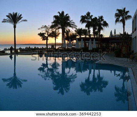 Africa, Egypt, January 11, 2016, Swimming pool with sun beds at the hotel,Africa, Egypt, January 11, 2016 - stock photo