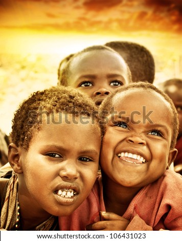 AFRICA, KENYA - NOV 8: Portrait of African children from the Masai Mara tribal village, near the Masai Mara National Park Reserve on November 8, 2008 in Kenya, Africa - stock photo