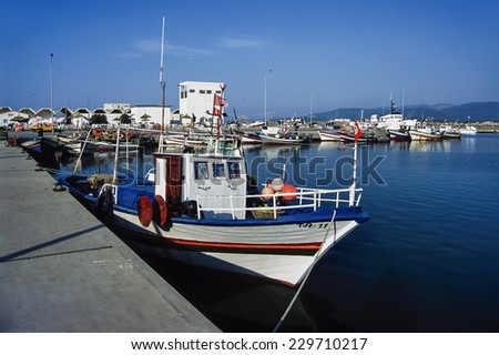 Africa, Tunisia, Tabarka, wooden fishing boats in the port - FILM SCAN - stock photo