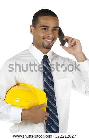 African American architect holding hardhat and using cellphone over white background - stock photo