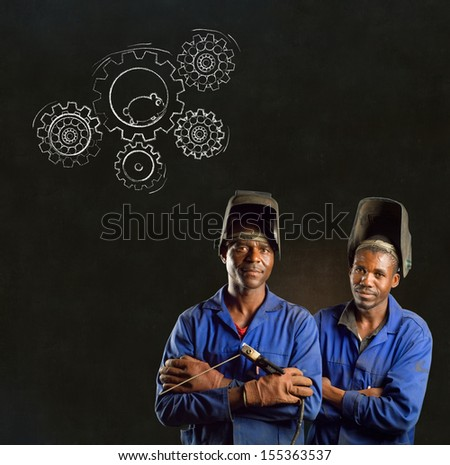 African American black men industrial workers with chalk hamster gears on a blackboard background - stock photo