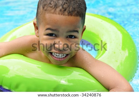 African American boy in swimming pool - stock photo